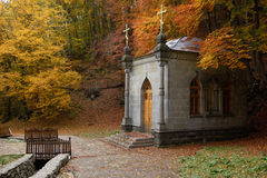 Chapel in autumn forest Stock Images