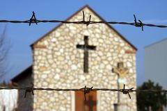 Chapel behind the barbed wire Royalty Free Stock Images