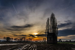 Chapel in the Belgian Country Side. A little chapel in the Flemish Ardennes on new years eve against the setting sun Royalty Free Stock Images