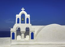 Chapel with the bell in Oia against blue sky in Santorini Royalty Free Stock Photos