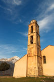 Chapel and bell tower near Pioggiola in Corsica. Old chapel and bell tower near Pioggiola in the Balagne region of Corsica with a snow capped San Parteo in the Royalty Free Stock Images