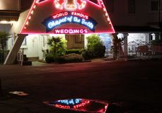 Chapel of the Bells at night, Las Vegas. Las Vegas, USA - 23 August 2016. World Famous Chapel of The Bells wedding chapel with its reflection in the puddle Stock Photos
