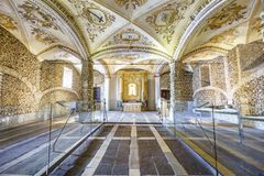 Chapel of Bones in Royal Church of St. Francis, Evora, Alentejo, Portugal. Spacious interior with bone-laid walls and frescoes on the ceiling, Chapel of Bones in stock image