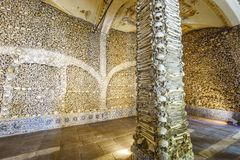 Chapel of Bones in Royal Church of St. Francis, Evora, Alentejo, Portugal. Wide-angle close-up of a bone-laid pillar and wall, Chapel of Bones in Royal Church of stock images