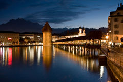 Chapel Bridge. The beautiful chapel bridge, Lucerne, Switzrenalnd, with Mount Pilatus in the background. This is a pedestrian only bridge to cross the small part Royalty Free Stock Photo