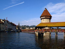 Chapel Bridge in Lucerne/Luzern, Switzerland. The Chapel Bridge - a 14th century wooden bridge part of the town's fortifications and the water-tower (octagonal Stock Photos