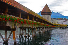 Chapel Bridge of Luzern. The much-visited wooden Chapel Bridge on Lake Lucerne, Switzerland with Mount Pilatus of the Alps in the background Royalty Free Stock Photo