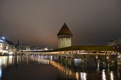 "Chapel Bridge in Luzern at dusk , Switzerland. Chapel /Chappel Bridge and Water Tower in Luzern, Switzerland.Chapel/Chapels Bridge or Chappels bridge ""Kapellbr Stock Photography"