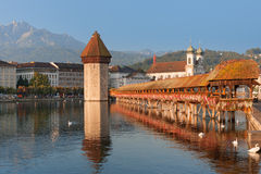 Chapel Bridge in Luzern in the morning. Chapel Bridge and Water Tower in Luzern in the morning Stock Photos