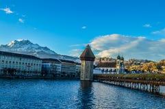 """Chapel Bridge in Luzern, Switzerland in blue. Chapel /Chappel Bridge and Water Tower in Luzern, Switzerland.Chapel/Chapels Bridge or Chappels bridge """"Kapellbr Stock Image"""