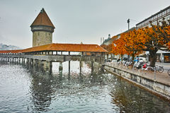 Chapel Bridge over Reuss River and autumn tree in Lucerne, Switzerland Royalty Free Stock Images