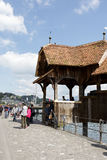 Chapel Bridge over the river Reuss. LUCERNE, SWITZERLAND - MAY 04, 2016: Entry to the roofed wooden Chapel Bridge. This bridge is one of the most recognizable Stock Photo