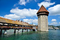 Chapel Bridge tower in Lucerne, Luzern Switzerland. A view of the famous wooden Chapel Bridge of Luzern, Lucerne in Switzerland, with the tower in foreground Royalty Free Stock Image