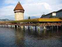 Chapel bridge and the Water Tower, Lucerne. The Chapel Bridge (Kapellbr�cke) in Lucerne, Switzerland is a 204 m (670 ft) long wooden bridge originally built in Royalty Free Stock Photo