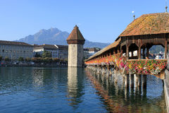 Chapel Bridge, Water Tower and Pilatus, Lucerne. View across the River Reuss at Lucerne (Luzern) in Switzerland past the Chapel Bridge (Kapellbrucke) and Water Royalty Free Stock Image