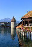 Chapel Bridge, Water Tower and Pilatus, Lucerne. View across the River Reuss at Lucerne (Luzern) in Switzerland past the Chapel Bridge (Kapellbrucke) and Water Stock Photo