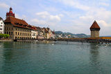 Chapel Bridge and Waterfront of Reuss river, Lucerne, Switzerlan Royalty Free Stock Photo
