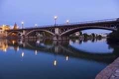 Chapel of Carmen and Isabel II Bridge in Seville. Seville, Andalusia, Spain Royalty Free Stock Photos