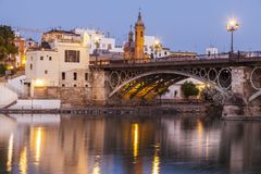 Chapel of Carmen and Isabel II Bridge in Seville. Seville, Andalusia, Spain Stock Photography