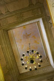 Chapel ceiling. Ceiling of a chapel with a list and an old chandelier Royalty Free Stock Photography