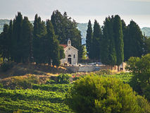Chapel and cemetery. In cypress grove on a  mountain peak Stock Photo