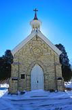 Chapel in Cemetery. A beautiful chapel in a cemetery in Burlington, Wisconsin with snow on the ground. Racine County - United States of America Royalty Free Stock Images