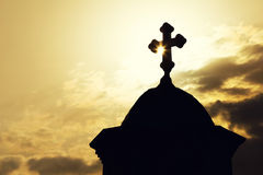 Chapel or church roof with a cross in silhouette Stock Photo