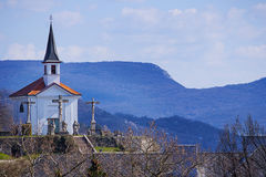 Chapel on the city hill. Little chapel in the town hill with many statues  in front of the entrance. Blue mountains and blue sky is background  for it. Estergom Royalty Free Stock Image