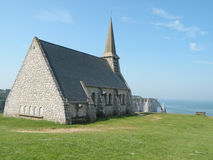 Chapel on coast. Historic chapel on the scenic coast of France near the town of Etretat overlooking the Atlantic Ocean Royalty Free Stock Photography