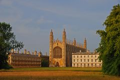 The landscape view of the majestic King`s College Chapel building from across the field and River Cam from The backs. The chapel is considered one of the finest stock images