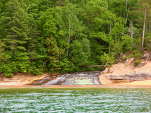 Chapel Creek Cascade Michigan. Chapel Creek flows into Lake Superior at Pictured Rock National Lakeshore in Michigan Royalty Free Stock Photo