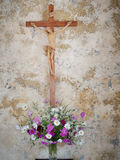 Chapel cross with flowers. Stock Photography