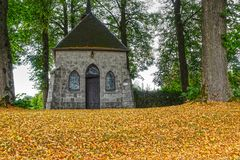 Chapel, early fall of leaves Stock Photography