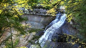 Chapel Falls in the Upper Peninsula of Michigan. Chapel Falls surrounded by autumn colors. This waterfall is located at Pictured Rocks National Lakeshore in stock video