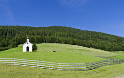 Chapel on a fenced meadow Stock Photography