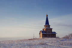 Chapel in the field. Church among snow Royalty Free Stock Images