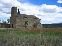 Chapel in a field of Poppies, Spain. A ruin of a chapel in a field full of poppies, Spain Stock Photo