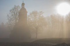 Chapel in the fog. Mysterious chapel in the fog Stock Images
