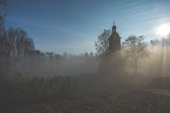 Chapel in the fog. Mysterious chapel in the fog Stock Photos
