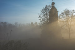 Chapel in the fog. Mysterious chapel in the fog Royalty Free Stock Photos