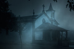 Chapel in a foggy night Royalty Free Stock Image