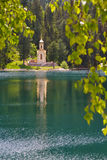 Chapel in forest with a lake. Small church at the shore of Siberian lake stock photos