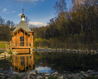 Chapel in a forest near a spring. Royalty Free Stock Photo