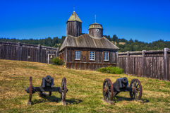 Chapel of Fort Ross. Old Russian cannons in front of the Chapel of Fort Ross in Former Russian-American Company trading post and fortress royalty free stock image
