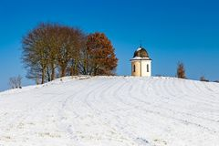 Chapel on a hill in winter. Chapel on a hill in Bavaria, Germany in winter royalty free stock image