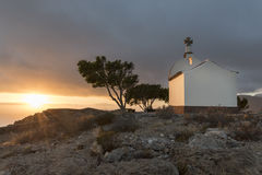Chapel on a hill at sunset. On the island Stock Photos