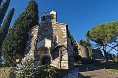 Chapel of Holy Spirit and castle of Gorizia. The chapel of Holy Spirit and behind the entrance to the castle of Gorizia Royalty Free Stock Photos
