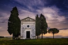 Chapel of the Madonna di Vitaleta. Also know as Cappella della Madonna di Vitaleta.  In San Querico d`Orcia, Tuscany, Italy.  Taken just before sunrise Stock Image