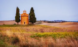 Chapel of the Madonna di Vitaleta. Also called Chappella della Madonna di Vitaletta in rolling hills in Tuscany Royalty Free Stock Images