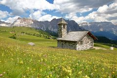 The Chapel of Mastle located near Raiser Pass, with Puez Odle mountain range on the left and Sella Group mountains on the right stock photo
